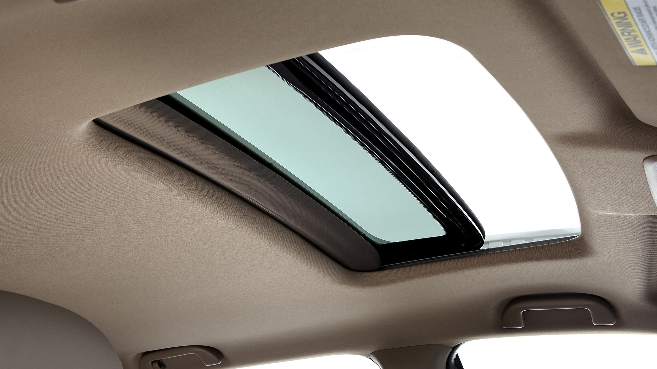 One-Touch Power Moonroof detail on 2020 Honda Pilot EX-L with Beige interior.