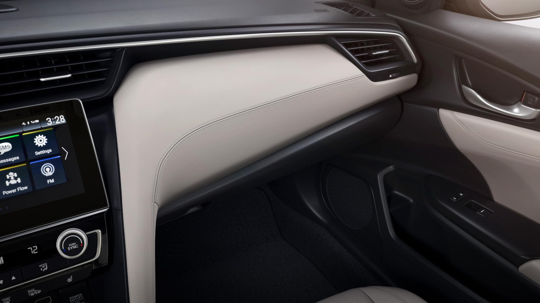 Interior close-up view of dash trim on 2021 Honda Insight Touring with Ivory Leather.